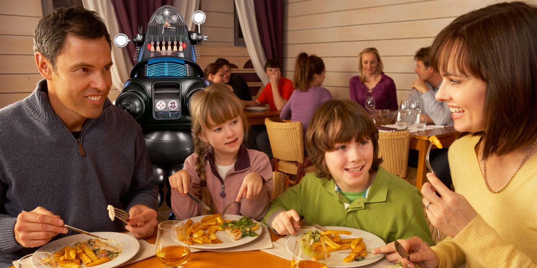 family eating at restaurant - 1200×600