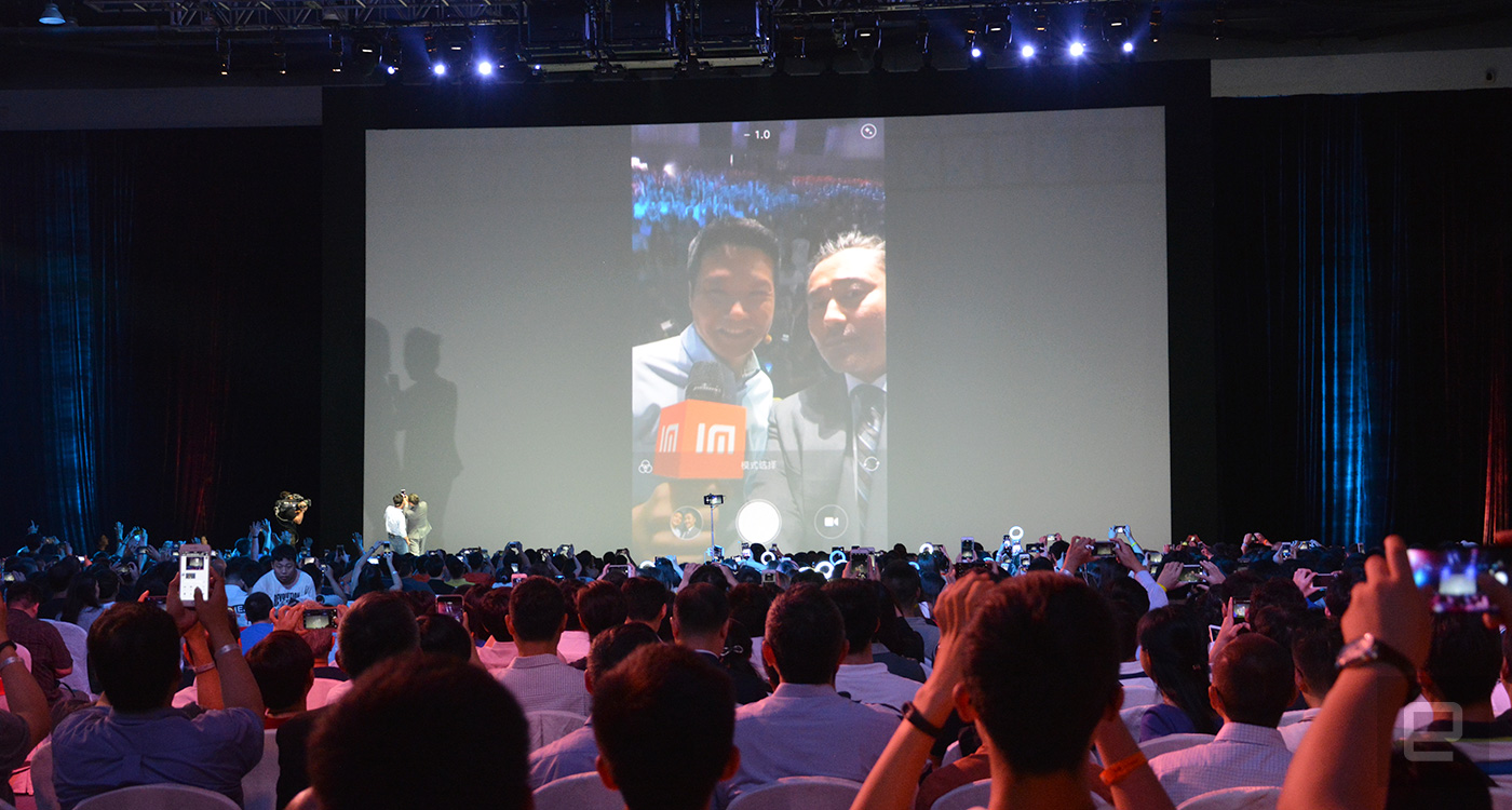 Xiaomi CEO Lei Jun with Redmi celebrity spokesperson Wu Xiubo take a selfie on the stage.