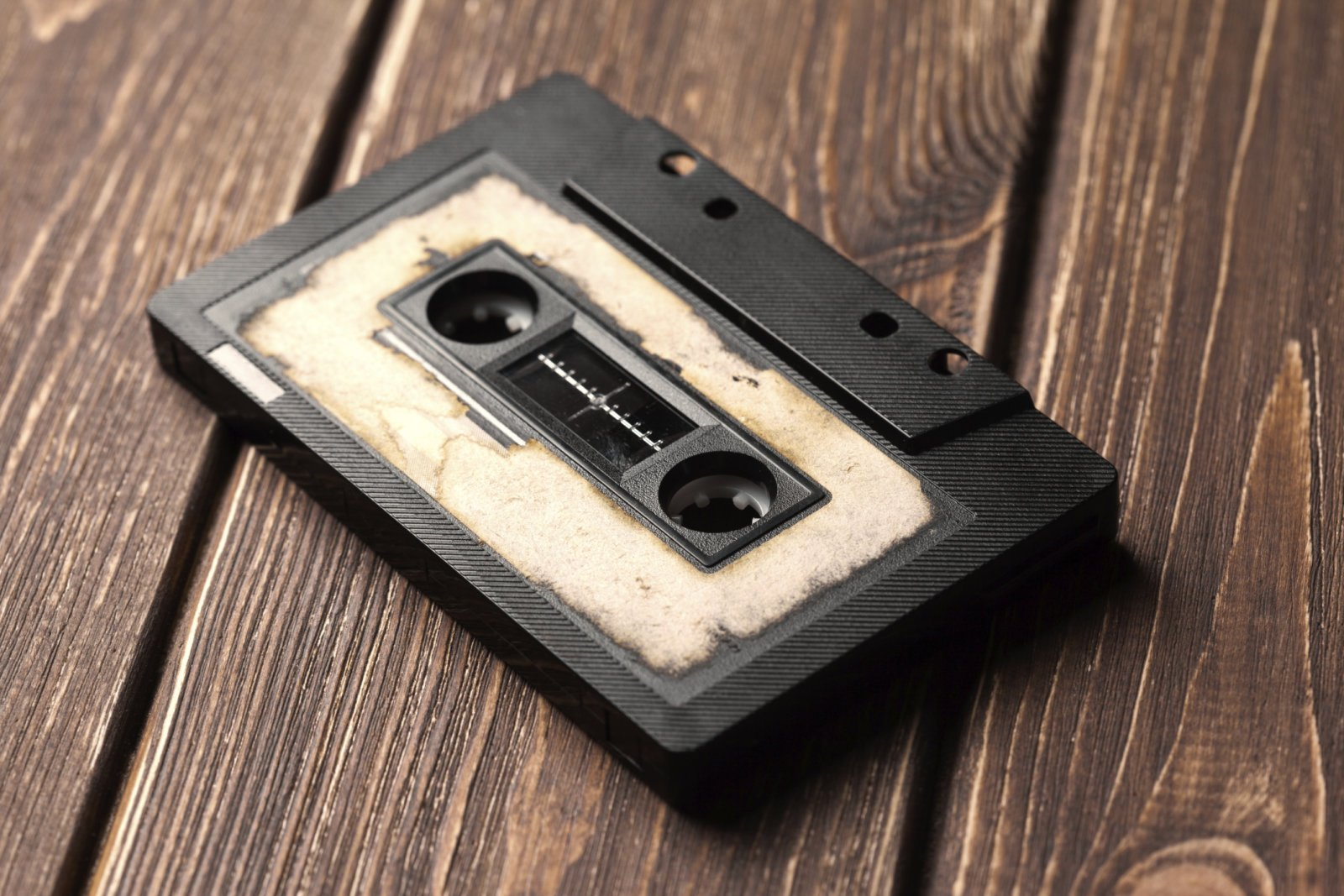 audio cassette with magnetic tape on wooden background