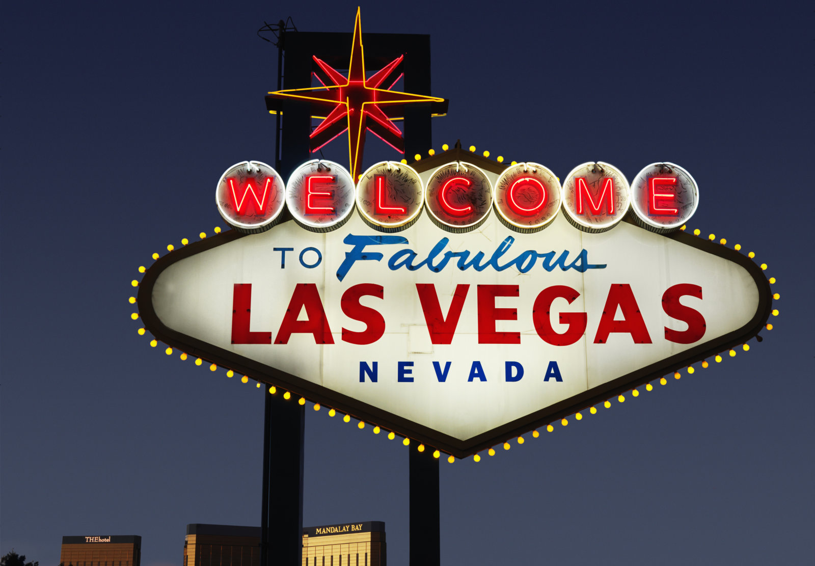 Lighted Las Vegas, Nevada welcome sign with night sky.