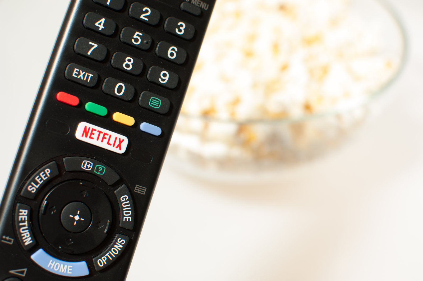 Remote control smart TV with Netflix button with popcorn.