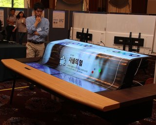 LG rolls out the world's first 77-inch flexible OLED display