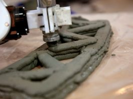 A 3D-printed bridge is being built using reinforced concrete