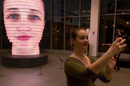 Giant art installation displays 3D selfies on an enormous 850,000-LED 'head'