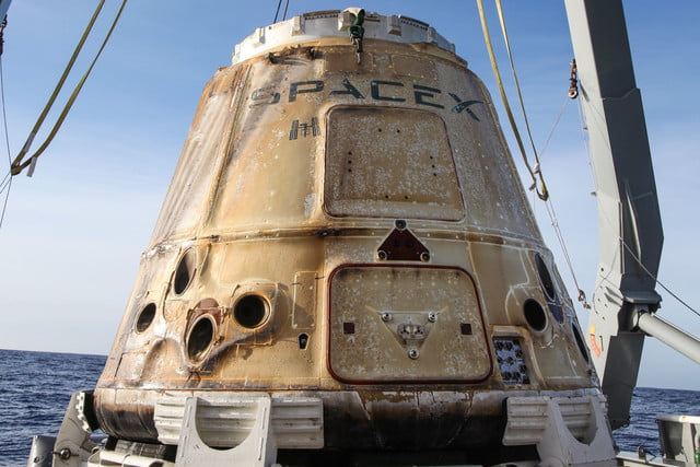 After a month-long stay at the space station, Dragon capsule returns to Earth