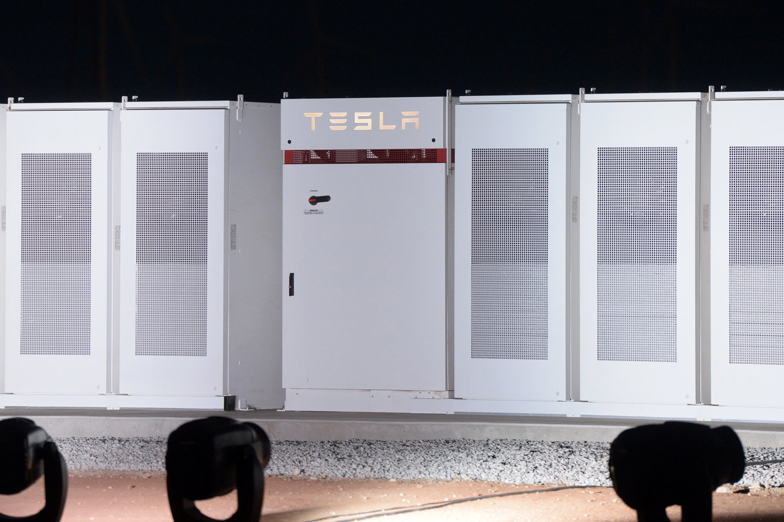 Tesla Inc. Powerpacks that will be used to form the world's largest lithium-ion battery stand on display at the Hornsdale wind farm, operated by Neoen SAS, near Jamestown, South Australia, on Friday, Sept. 29, 2017. Tesla Chief Executive Officer Elon Musk descended on South Australia on Friday to unveil progress on a giant battery seen critical to averting crippling power shortages in the state. Photographer: Carla Gottgens/Bloomberg via Getty Images