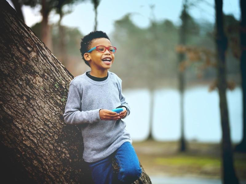 boy_leaning_on_tree.jpg?itok=PapNk7NF