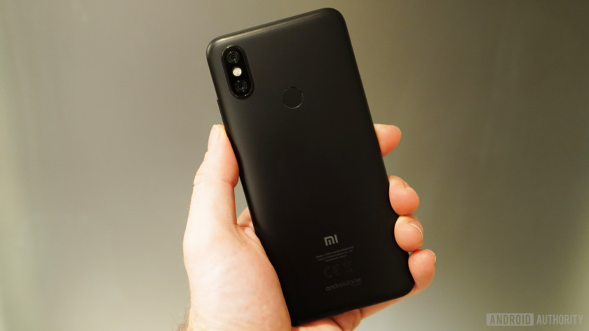 The Xiaomi Mi A2 in a hand from behind.