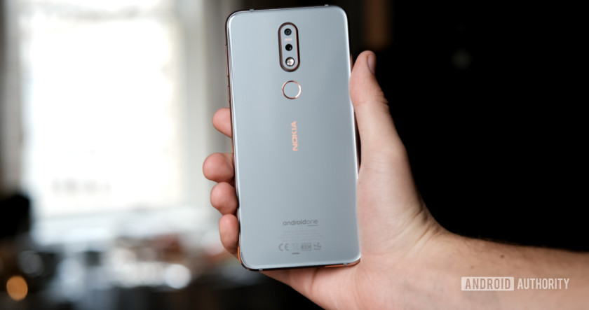 Nokia 7.1 holding back of phone, Nokia 7.1 review