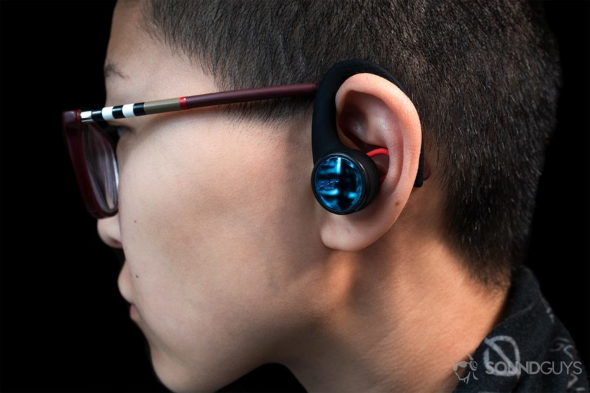 Plantronics BackBeat Fit 3100: A woman wearing the earbuds in profile view to show the size.