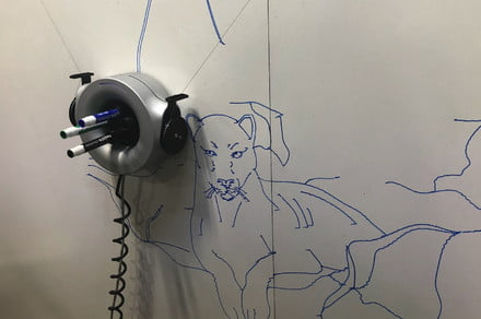 Scribit graffiti robot climbs your walls to draw (and erase) giant artwork