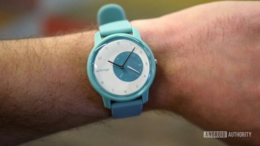withings move fitness watch light blue on wrist