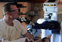 Body surrogate robot helps people with motor impairments care for themselves
