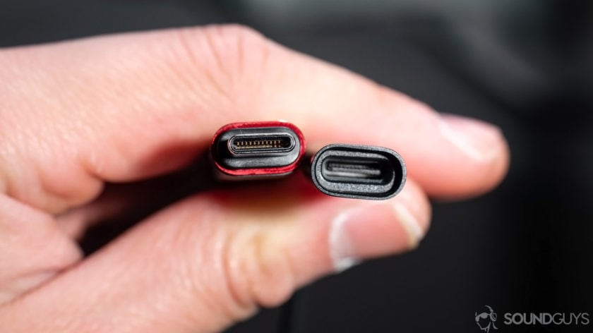 Huawei Freelace: A close-up of the USB-C module built into the neckband. The pieces are held in a hand to show the male and female ends.