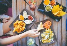American Express expands its dining services by purchasing restaurant app Resy