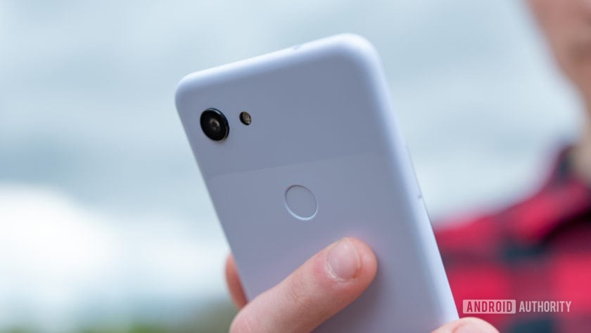 Google Pixel 3a Purple-ish Holding Phone Close