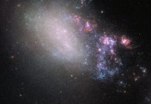 Two galaxies play tug of war in this spectacular Hubble image
