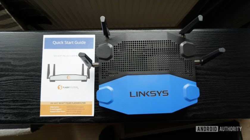 Flashrouters picture of Linksys-3200 with quick start guide