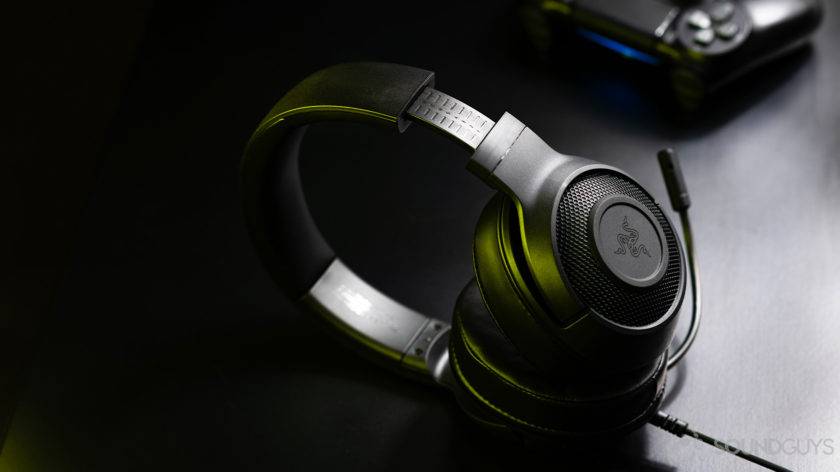The Razer Kraken X headphones angled away from the camera resting on a black surface.