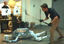 Tormented robot pulls a gun on its creators in latest Boston Dynamics spoof