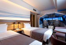 Airport hotel builds a full-size flight simulator into one of its guest rooms