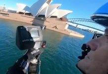 Jetpack pilot flies around Sydney Harbour and stays dry, unlike before