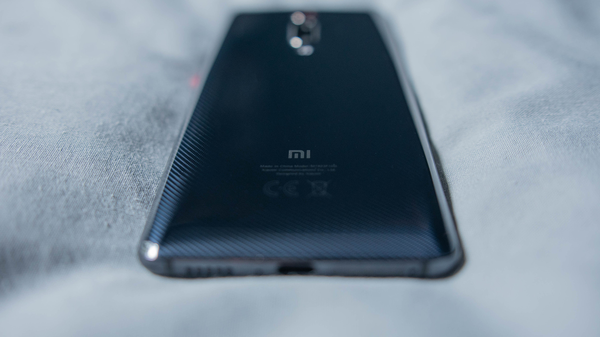 Xiaomi Mi 9T Rear casing depth shot on soft surface
