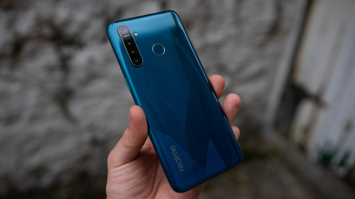 Realme 5 Pro rear view in hand holding phone