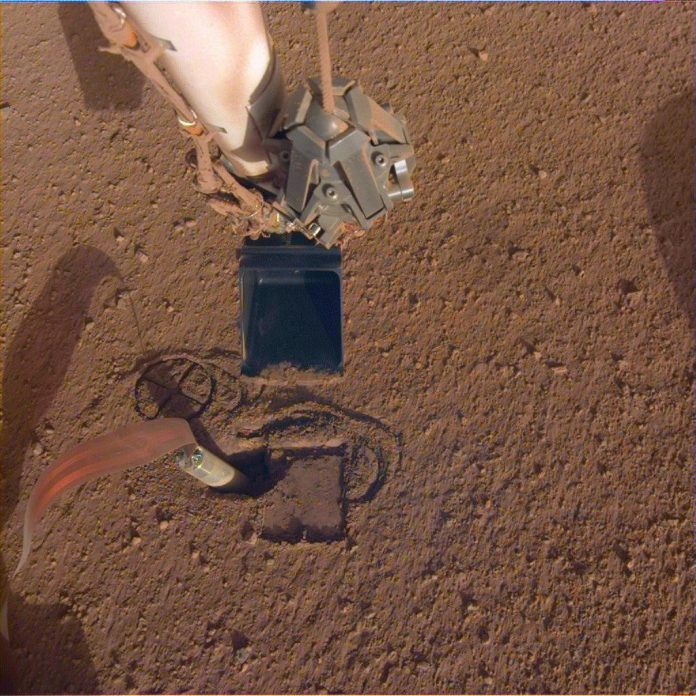 Can the InSight lander free its stuck drill and continue exploring Mars?