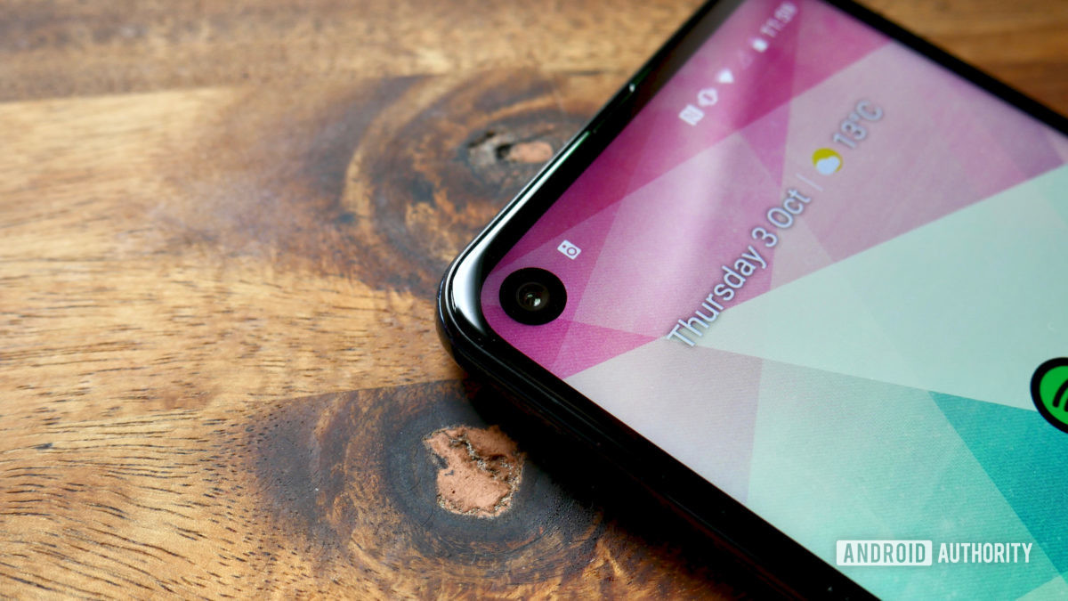 motorola one action review punch hole