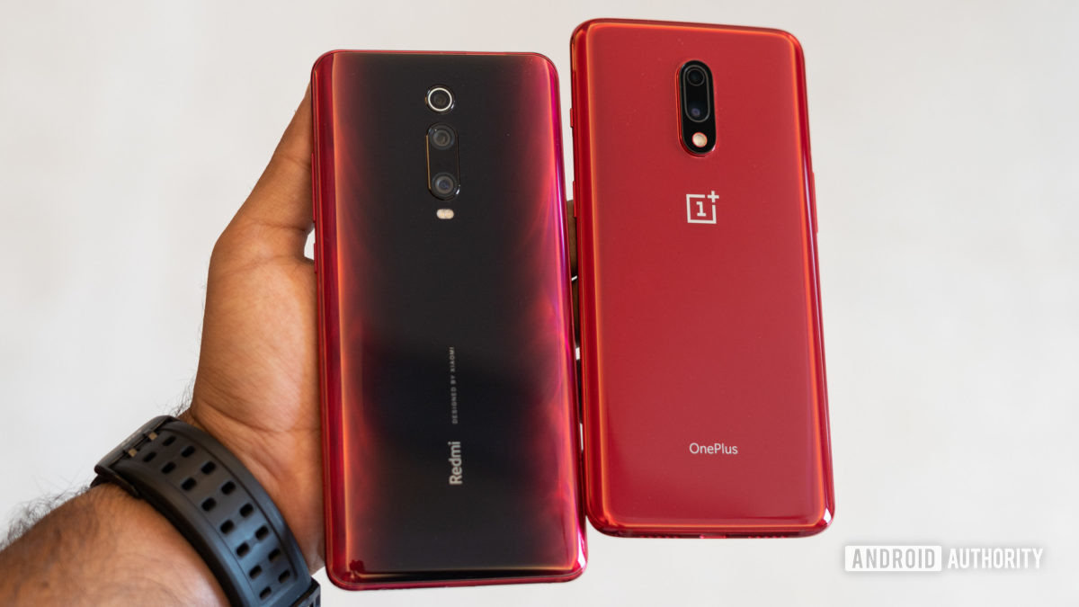 Redmi K20 Pro vs OnePlus 7 showing back of the phones in hand