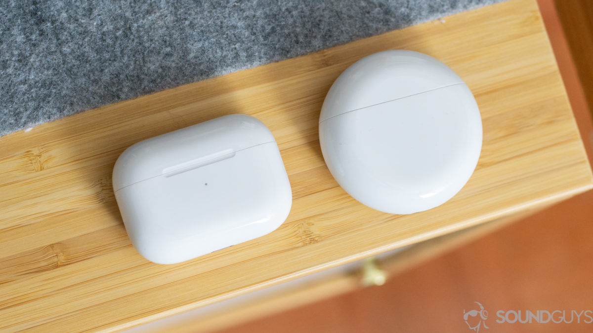 Both white charging cases pictured from above on a wood desk
