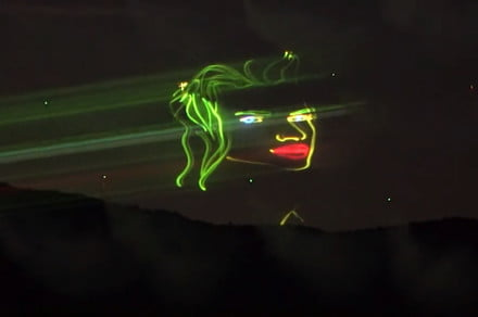 Amazing aerial drone display uses smoke machines and laser projection