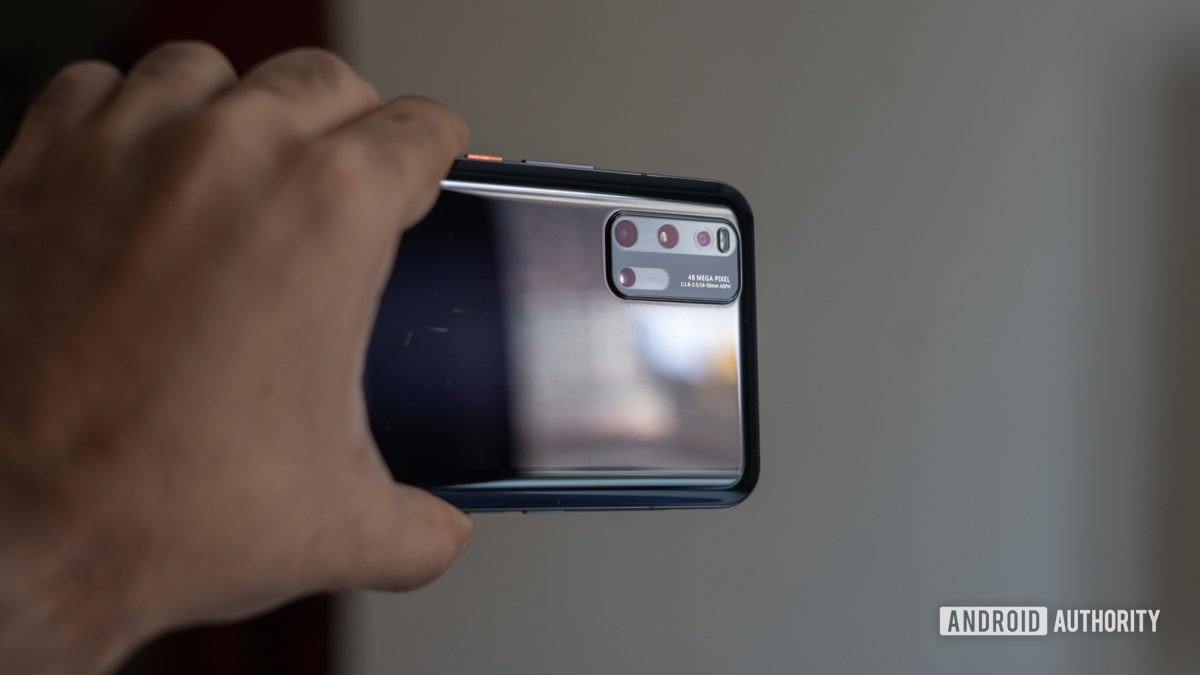 Iqoo 3 in hand showing camera