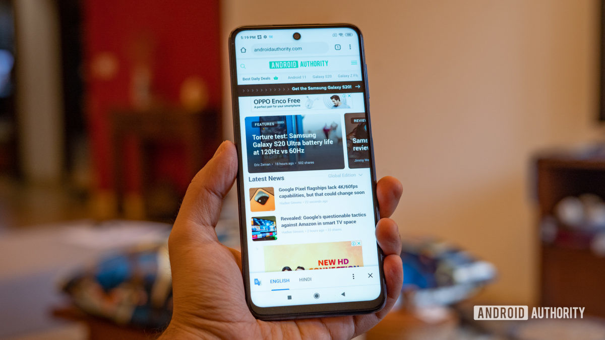 Redmi Note 9 Pro in hand with browser open