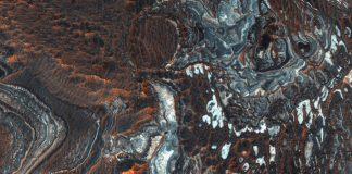 See the strange and beautifully layered terrain of Mars' Juventae Chasma
