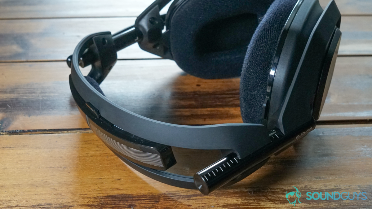 The Astro Gaming A50 Wireless sits on a wooden table, displaying the headband.