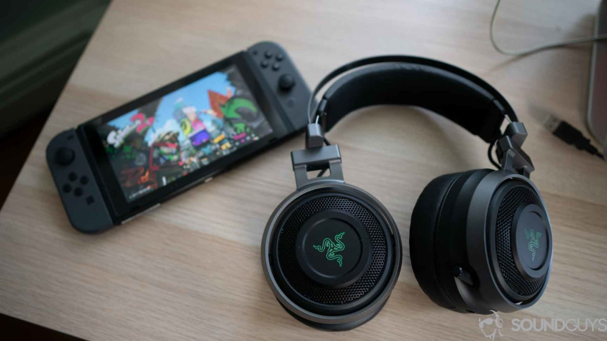 A picture of the Razer Nari Ultimate gaming headset next to a nintendo switch.