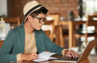 man studying in cafe on laptop