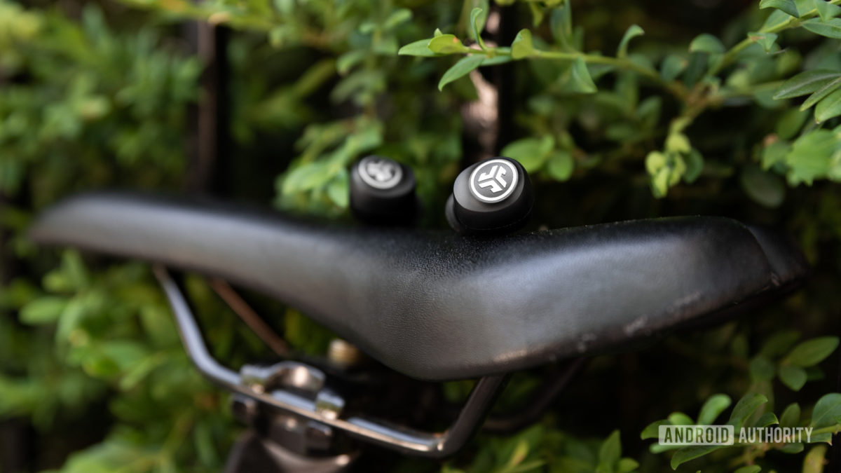 A photo of the JLab GO Air cheap true wireless earbuds sitting atop a bike saddle.