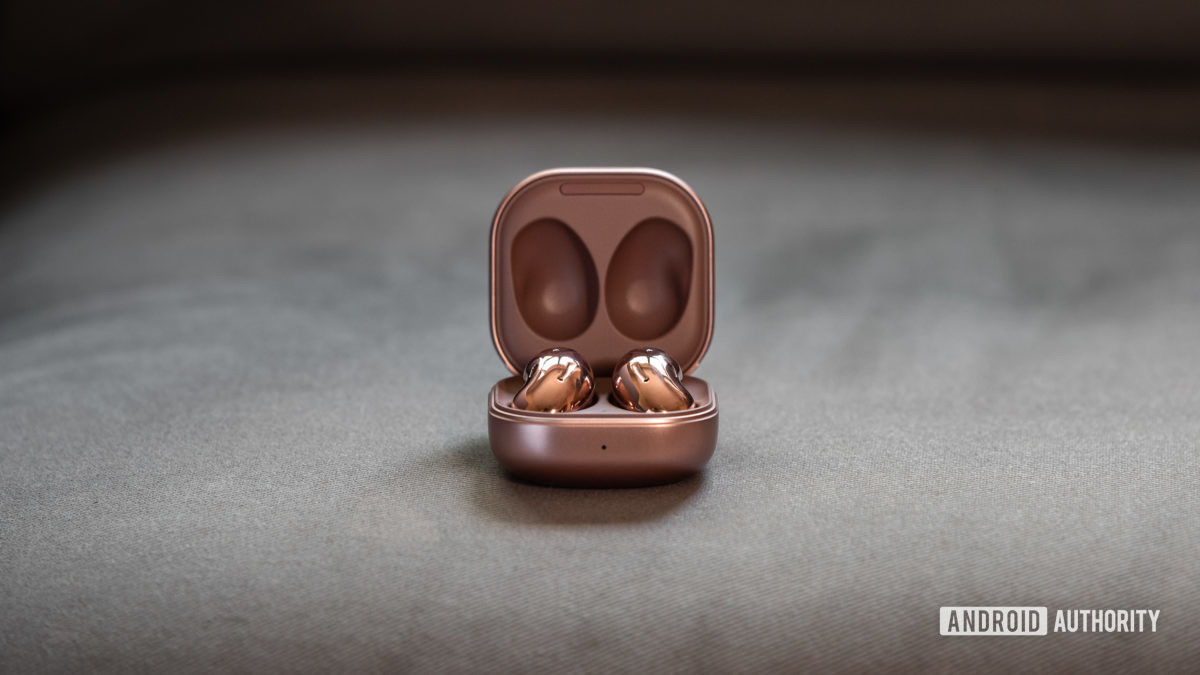 A picture of the Samsung Galaxy Buds Live noise cancelling true wireless earbuds in the case against a gray background.