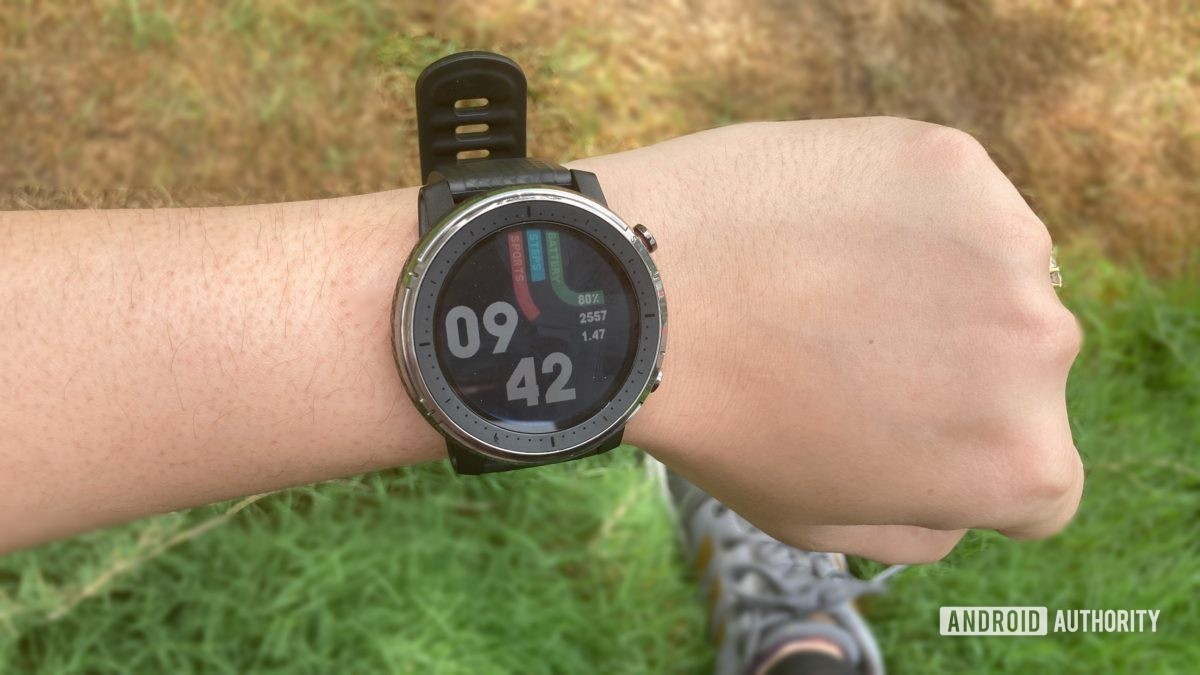 Amazfit Stratos 3 strapped on a wrist showing default watchface