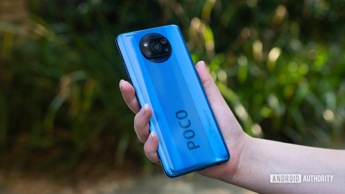 Xiaomi Poco X3 NFC held in the hand outside to show off the rear side