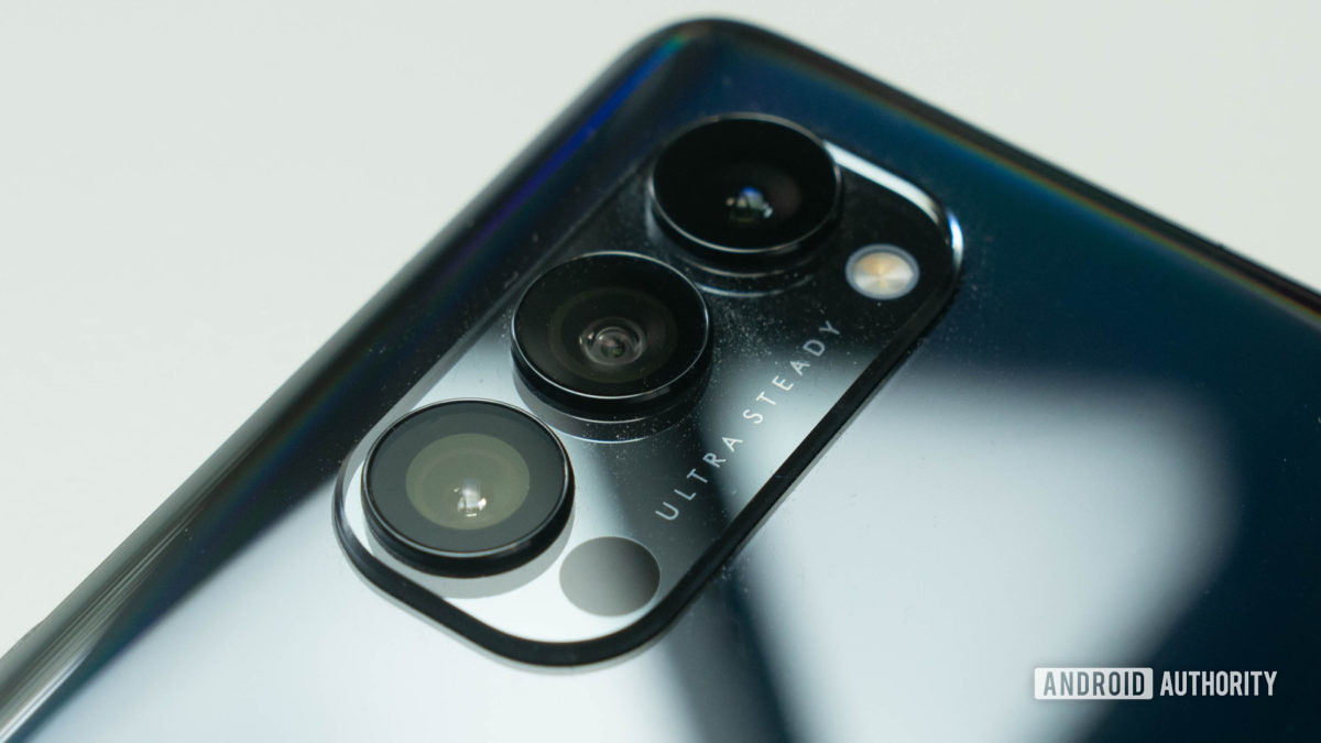 Oppo Reno 4 Pro 5G rear triple camera bump at an angle and on a white table