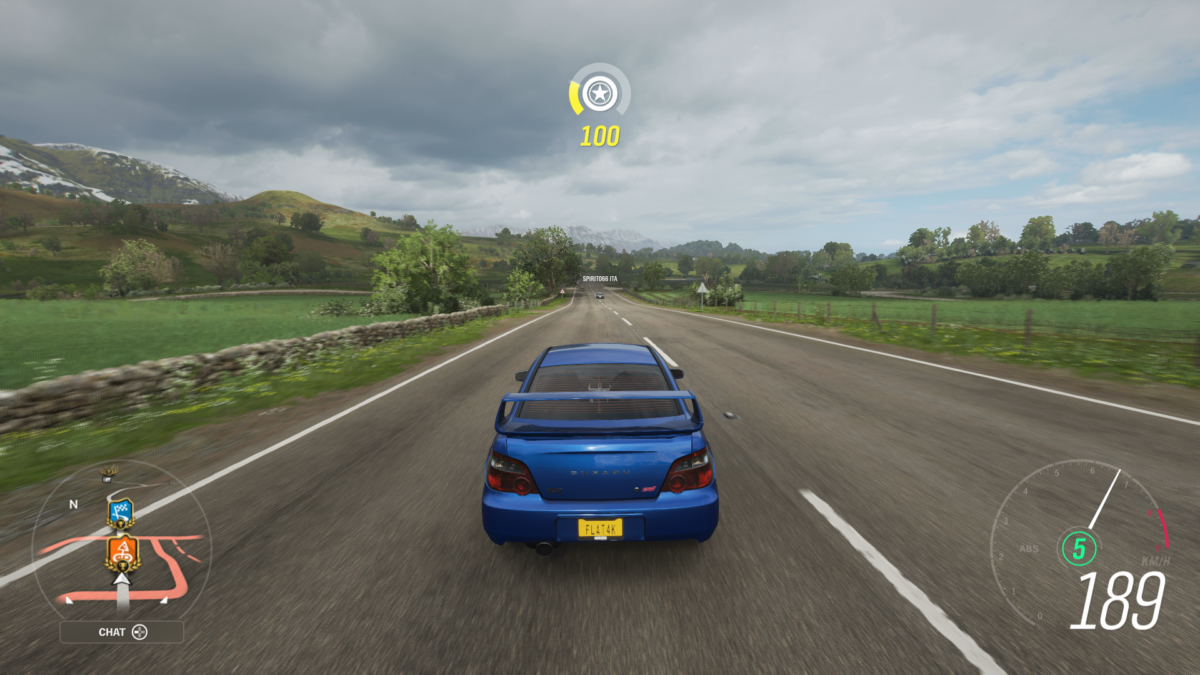Xbox Series S screenshot of Forza Horizon 4 with a Subaru driving through the countryside
