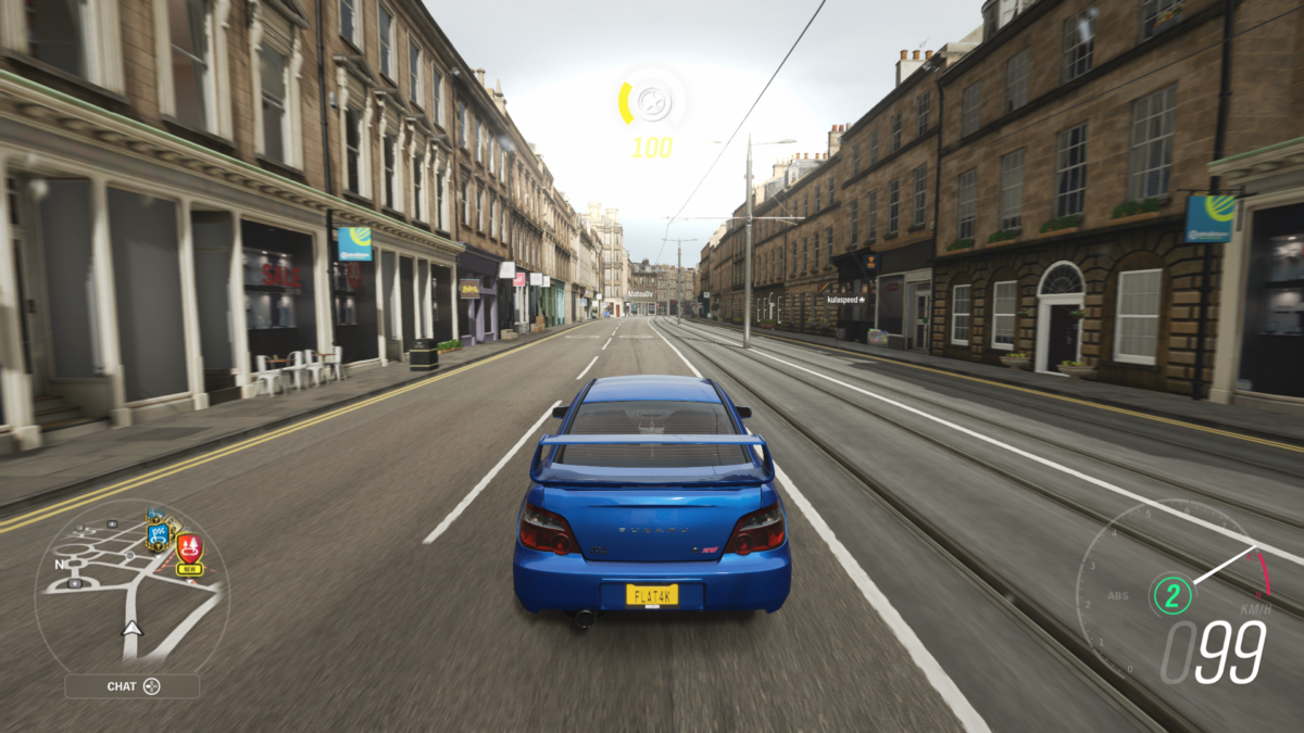 Xbox Series S screenshot of Forza Horizon 4 with a Subaru driving through the city