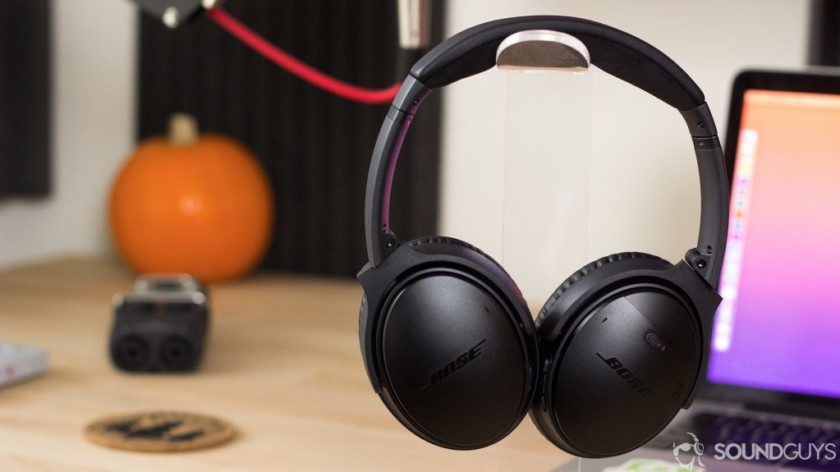 The Bose QuietComfort 35 II noise-cancelling headphones in black in front of a desk.