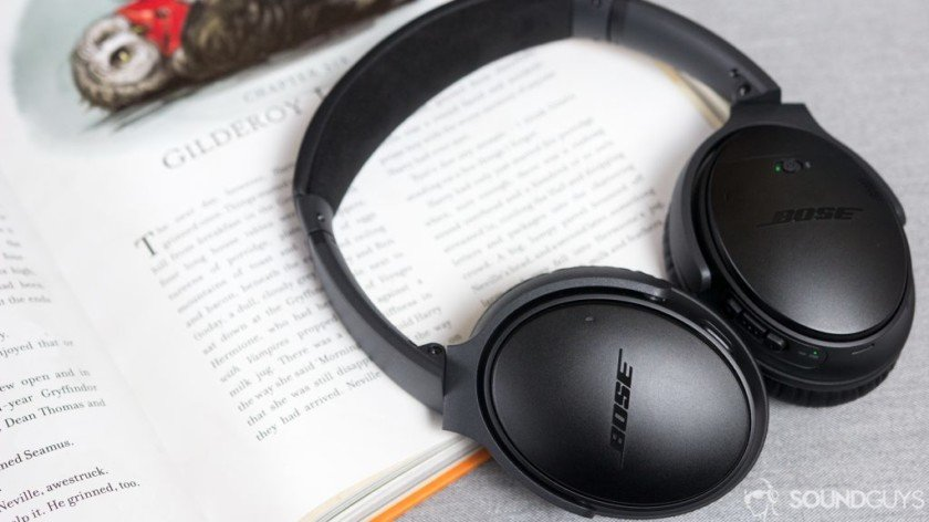 The Bose QuietComfort 35 II noise-cancelling headphones on top of an open book.