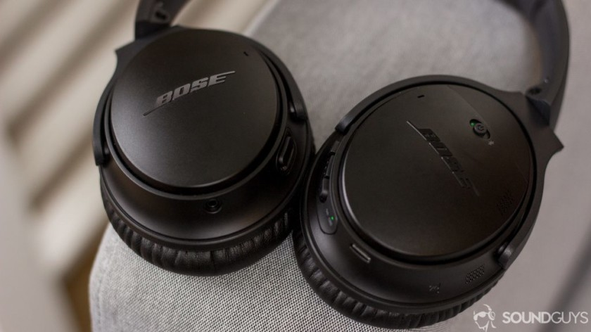 The Bose QuietComfort 35 II noise-cancelling headphones sit on a couch arm.