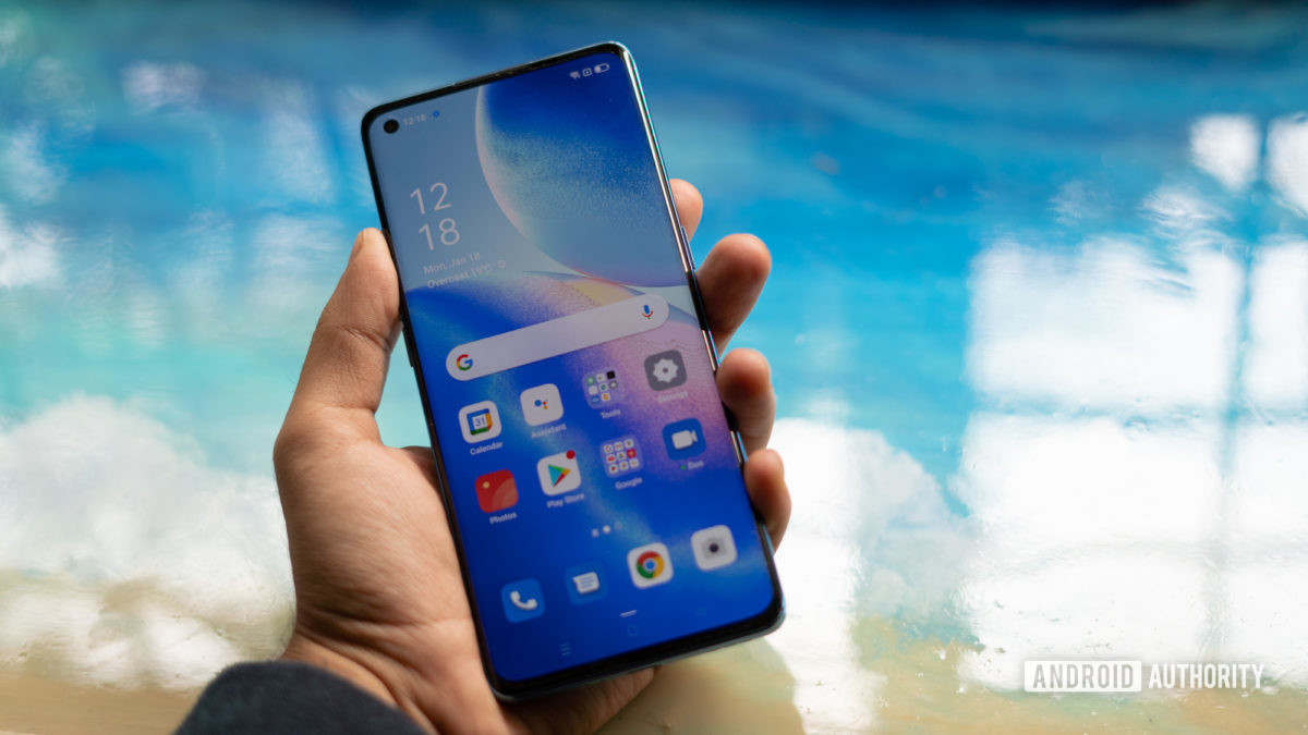 Oppo Reno 5 Pro showing display in hand